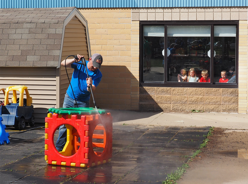 Charles City Valero volunteers help spruce up TLC: The Learning Center